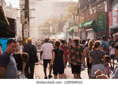 TORONTO, ON, CANADA - JULY 29, 2018: Street view of the crowd at Kensington market in Toronto