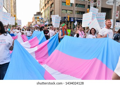 Toronto, ON, Canada - JUNE 21, 2019: Spectators display their support for transgender and non-binary people during the demonstration of the street of Toronto at Trans March and Pride Month.