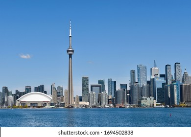 Toronto, ON, Canada, June 8, 2019 - Toronto Skyline from Lake Ontario. CN Tower and Rogers Centre next to office buildings and the financial core downtown