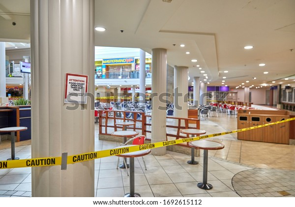 Toronto, ON. Canada - March 26, 2020: Sign on pillar tells customers food court is closed due to the COVID-19 global pandemic outbreak.