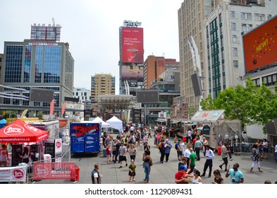 TORONTO, ON / CANADA - MAY 26, 2018: Toronto's Poutine Fest in Yonge-Dundas Square, shown here, hosted ten Poutine food trucks