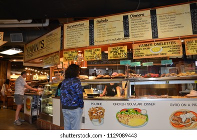 TORONTO, ON / CANADA - MAY 26, 2018: Shoppers visit Yianni's Kitchen inside the St. Lawrence Market.