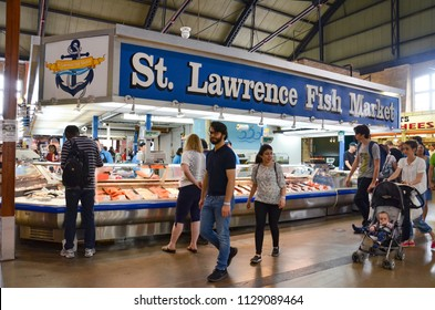 TORONTO, ON / CANADA - MAY 26, 2018: Shoppers walk near the St. Lawrence Fish Market inside the St. Lawrence Market.