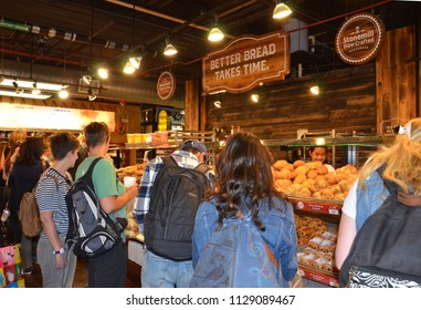 TORONTO, ON / CANADA - MAY 26, 2018: Shoppers stop at the Stonemill Bakehouse inside the St. Lawrence Market.