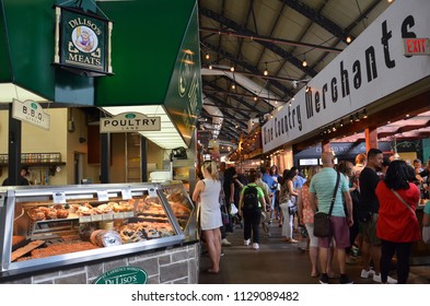 TORONTO, ON / CANADA - MAY 26, 2018: Shoppers walk near Diliso's Meats inside the St. Lawrence Market.