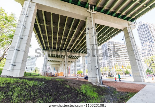 Toronto, ON / Canada - May 27, 2018: The Bentway is a new public space under the Gardiner Expressway in downtown Toronto designed by Public Work. The first phase will be complete in summer 2018.