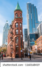 Toronto, ON, Canada - November 17, 2017: Iconic Gooderham Faltiron Building in Old Town on a Sunny Autumn Day. Built in 1892, this redbrick flatiron building features a basement pub.