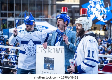 Toronto, ON/Canada - April 15, 2019: Fans Pose With a Sign at the Scotiabank Arena Viewing Party Prior to Game 3 of the 2019 Stanley Cup Playoffs