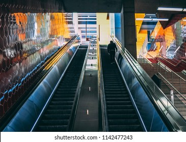 Toronto, ON/Canada - April 29, 2018: Man walking up an escalator in a subway station.
