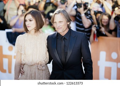 """TORONTO, ON/CANADA - SEPTEMBER 13, 2011:  Keira Knightley and Vigo Mortensen stop and pose for the media en route to the screening of their film """"A Dangerous Method"""" on September 13, 2011 in Toronto"""