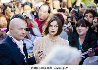 "TORONTO, ON/CANADA - SEPTEMBER 13, 2011:  Keira Knightley signs autographs at at the screening of ""A Dangerous Method"" on September 13, 2011 in Toronto"