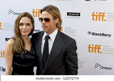 TORONTO, ON/CANADA - SEPTEMBER 9, 2011:  Hollywood power couple Brangelina graces the red carpet for the screening of Brad`s latest flick Moneyball on September 9, 2011 in Toronto