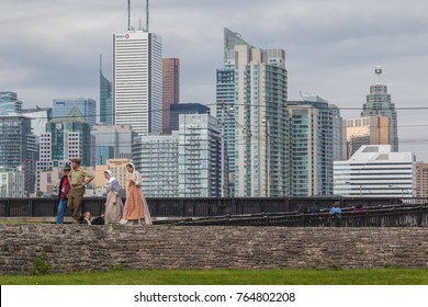TORONTO, ONT, CANADA- MAY 27, 2017:  Staffs dressing up in costumes  in Fort York National Historic Site with city in background.  Canada's largest collection of War of 1812 and 1813 battle site.
