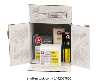 "Toronto, Ontario / Canada - 02 15 2019: Shipping box from Ontario Cannabis Store with illustration and logo. Slogan ""Only legal Cannabis"" and ""Consume Responsibly"" printed on box in French and English"