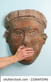Toronto, Ontario, Canada - April 14, 2007: Hand on mouth of mask to speak no evil