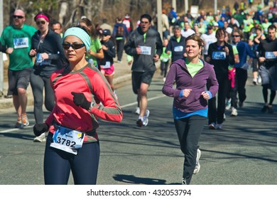 TORONTO, ONTARIO, CANADA - APRIL 2, 2011: A large group of runners run at Harry's Spring Run Off 8k & 5k Canada Running Series.