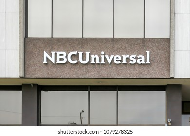 Toronto, Ontario, Canada - April 27, 2018: Sign of NBCUniversal on the building in toronto. NBCUniversal is an American multinational media conglomerate that is a subsidiary division of Comcast.