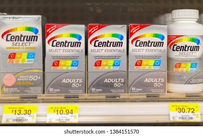 Toronto, Ontario, Canada- April 6, 2019:   Centrum vitamins bottles stacked in the pharmacy's shelf. Centrum is a brand of multivitamins produced by Pfizer