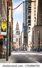 Toronto, Ontario, Canada - April 8, 2020: Downtown Toronto with view of Old City Hall. Downtown Toronto during Coronavirus pandemic.