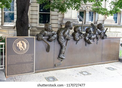 "TORONTO, ONTARIO, CANADA - AUGUST 14, 2018; ""Our Game"" sculpture by Canadian artist Edie Parker located outside the Hockey Hall of Fame building; at 30 Yonge Street, Toronto, Ontario, Canada"
