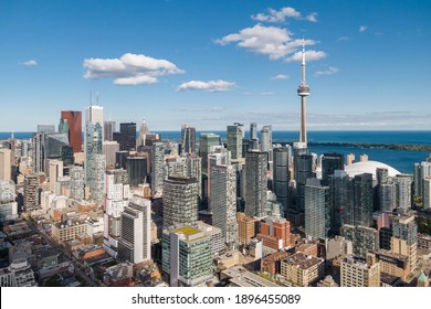 Toronto, Ontario, Canada, daytime aerial view of Toronto cityscape including architectural landmark CN Tower and high rise buildings in the financial district.
