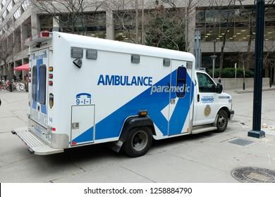 Toronto, Ontario / Canada - December 15 2018: A TPS (Toronto Paramedic Services) Ambulance is responding to an emergency outside the Toronto Eaton Centre.