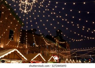 Toronto, Ontario, Canada - December 17, 2015: Lights strung over Trinity Street Distillery District for the Toronto Christmas Market