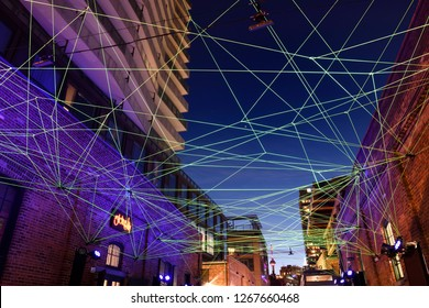 Toronto, Ontario, Canada - February 13, 2017: Green fiber optic cables for art installation at Toronto Light Festival at Distillery District with CN Tower