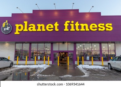 Toronto, Ontario, Canada - February 14, 2018: Planet Fitness  front view in Toronto. Planet Fitness is an American franchisor and operator of fitness centers.