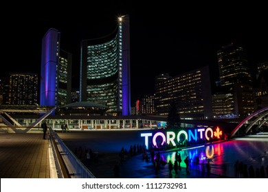 Toronto, Ontario / Canada - January 15, 2017: Toronto City Hall and skating rink in  Toronto, Ontario at night.