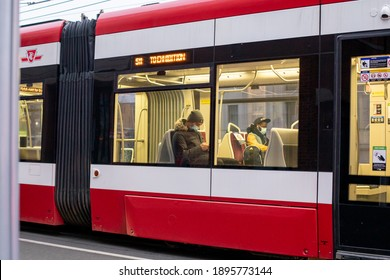 TORONTO, ONTARIO, CANADA - JANUARY 15, 2021: PEOPLE WEAR FACE MASKS ON TTC STREET CAR DURING COVID-19 PANDEMIC.