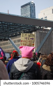 "TORONTO, ONTARIO, CANADA - January 20 2018 - Women's March, Large Crowds at Nathan Phillips Square, Feminism, Activism, Pussy Pink Hats, Equality Protest, ""I'm With Her"" signs, women's rights"