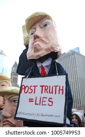 TORONTO, ONTARIO, CANADA - January 20 2018 - Women's March, Large Crowds, People Protest against American President Donald Trump, Puppet, Politics, Paper Idol Of USA Leader, Citizens Rally, Equality