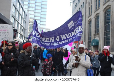 TORONTO, ONTARIO, CANADA - January 20 2018 - Women's March, Large Crowds at Nathan Phillips Square, Feminism, Activism, Pussy Pink Hats, Equality Protest signs, women's rights, LGBTQ, resistance