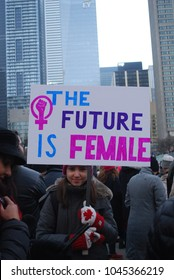 TORONTO, ONTARIO, CANADA - January 20 2018 - Women's March, Large Crowds at Nathan Phillips Square, Feminism, Activism, Pussy Pink Hats, Equality Protest signs, women's rights, LGBTQ, resistance, love