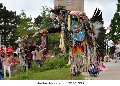 Toronto, Ontario / Canada - July 01, 2017: Indigenous native People in traditional Native Canadian clothing performing the traditional dance in the Canada Day Performance on July 01, 2017.