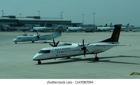 Toronto, Ontario / Canada - July 06 2018: An Air Canada Express Jet. New Q400 From Jazz Airlines. This Jet Has 2 PW150A Engines Rated For Continuous 5071 SHP (Shaft Horsepower) Each.