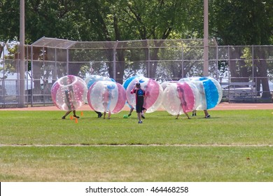 Toronto, Ontario, Canada - July 16, 2016: Bubble Madness dressed participants are taking part in soccer match.