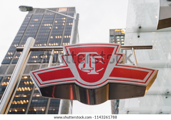 TORONTO, ONTARIO / CANADA - JULY 23 2018: TTC Sign, Downtown Toronto in Front of Glass Buildings