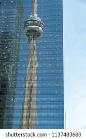 Toronto, Ontario, Canada - July 3, 2018:  Reflection of CN Tower in the windows of a building; vertical orientation.