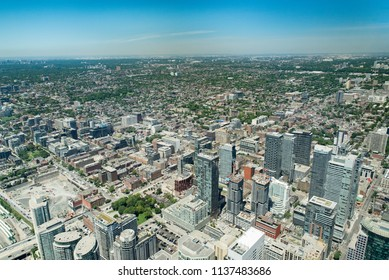 Toronto, Ontario, Canada - July 3, 2018:  Looking northwest from top of CN Tower toward York district in summer.