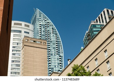 Toronto, Ontario, Canada - July 3, 2018:  Architectural diversity along The Esplanade east of Yonge Street in summer.