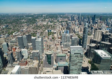 Toronto, Ontario, Canada - July 3, 2018:  Looking north from top of CN Tower toward North York district in summer.