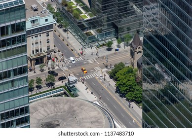 Toronto, Ontario, Canada - July 3, 2018:  Looking north from top of CN Tower at intersection of Simcoe Street and King Street West in summer.