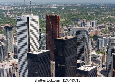 Toronto, Ontario, Canada - July 3, 2018:  Looking northeast from top of CN Tower toward the towers of Bay Street, Canada's main Financial District.  East York, Scarborough districts in distance.