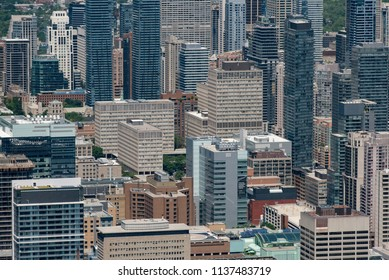 Toronto, Ontario, Canada - July 3, 2018:  Looking north from top of CN Tower at the concrete jungle of downtown.