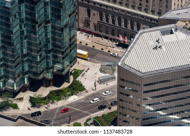 Toronto, Ontario, Canada - July 3, 2018:  Looking northeast from top of CN Tower in summer at University Ave. in foreground and York St. in front of Fairmont Royal York hotel, just north of Front St.