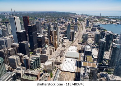 Toronto, Ontario, Canada - July 3, 2018:  Looking east from top of CN Tower toward Scarborough district and ports on Lake Ontario in summer; Union Station lower middle, Gardiner Expressway along right