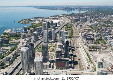 Toronto, Ontario, Canada - July 3, 2018:  Looking west from top of CN Tower along Lake Ontario toward Etobicoke and Mississauga.  Gardiner Expressway lower left to upper right.