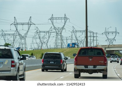 Toronto, Ontario, Canada - July 3, 2018:  Hydro electricity pylons/transmission towers along Highway 407 ETR westbound, west of Toronto, in summer.